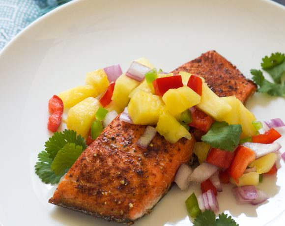 Chile spiced salmon is broiled to perfection, leaving a spicy and sweet crust on top and garnished with a fiery pineapple salsa that comes together in minutes!