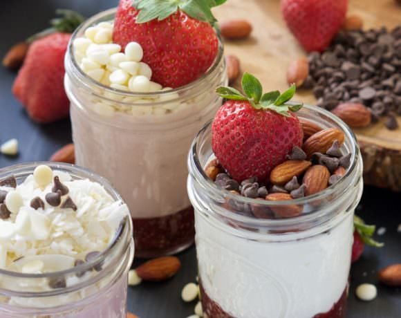 DIY Fruit on the Bottom Yogurt Cups are a healthy makeover of the store bought classic! A 3 ingredient chia seed fruit sauce is made then topped with your favorite yogurt and toppings of your choice!