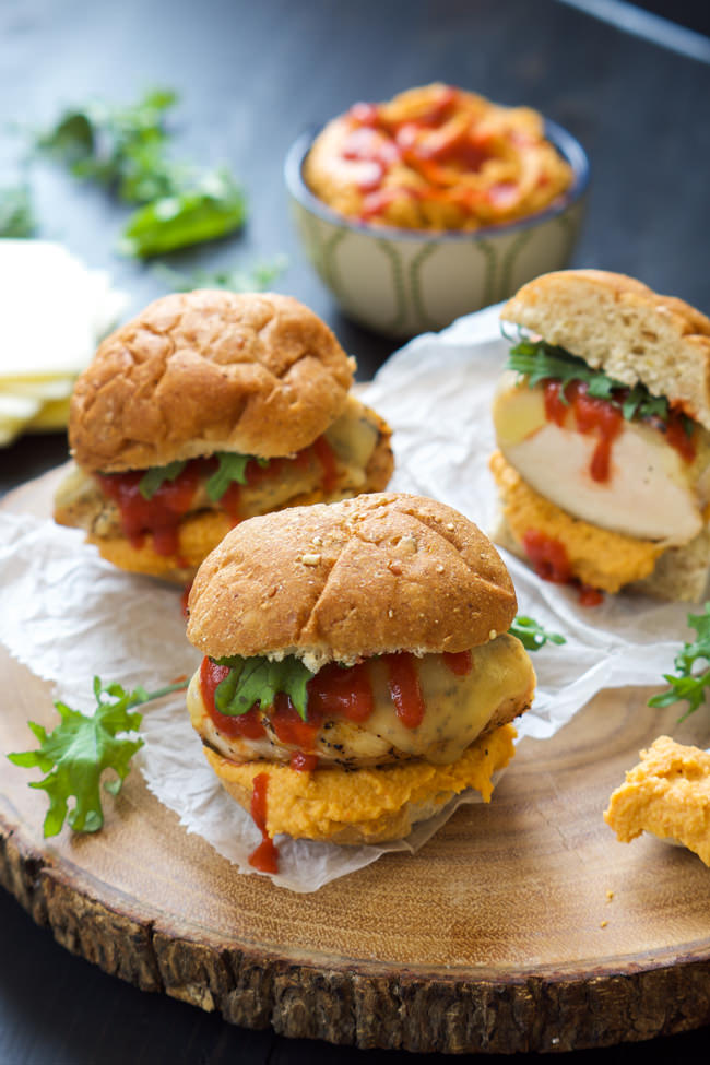 Sweet and spicy Honey Sriracha Hummus tops a juicy chicken sandwich loaded with gooey provolone for one flavorful bite!