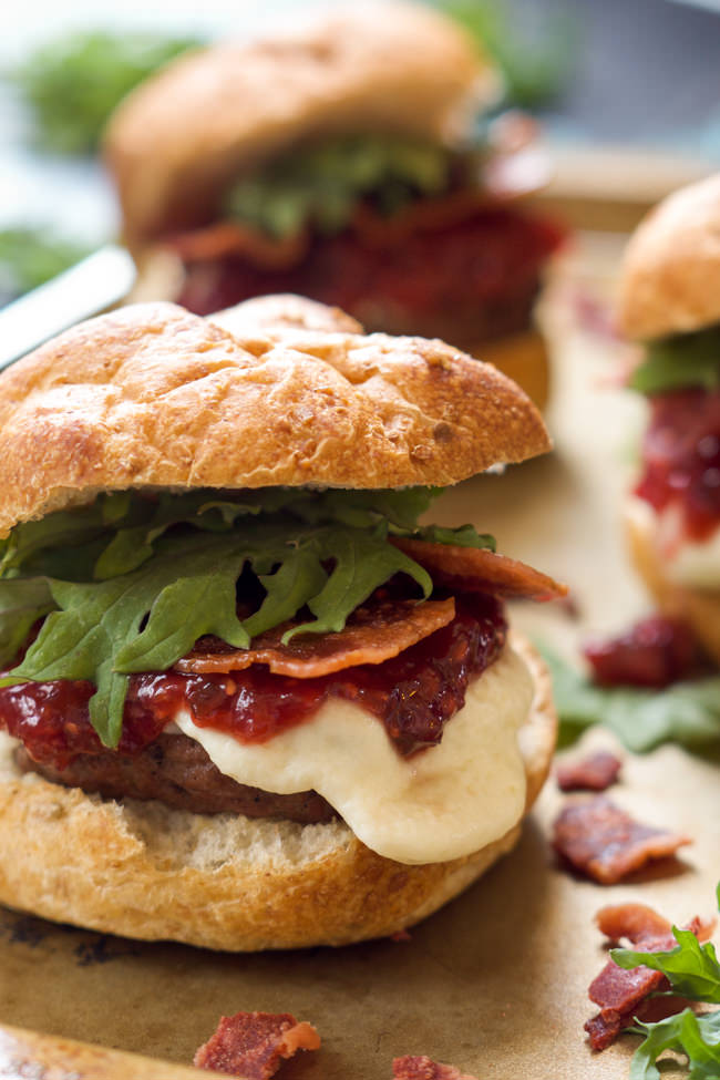 Fire up the grill for these sweet and spicy Raspberry Chipotle Mozzarella Sirloin Sliders! A homemade jelly over gooey mozzarella sirloin sliders is perfect for your next BBQ!