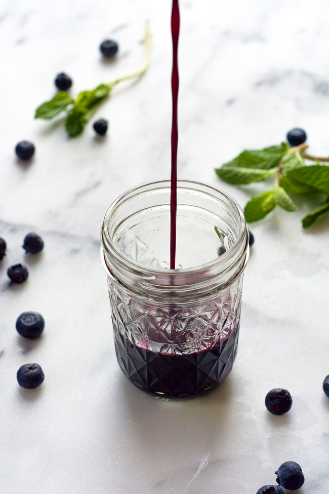 This Sparkling Blueberry Mojito Recipe is a fruity, summer staple that is easy enough to make for a crowd!