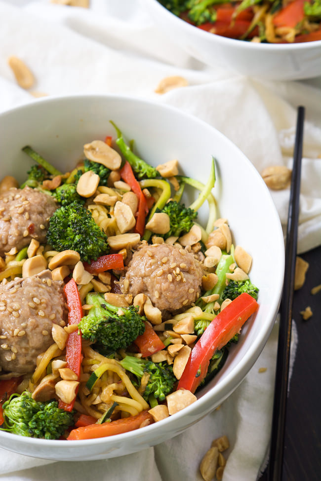 A quick soy and honey based sauce is tossed over Teriyaki Zucchini Noodles for a dinner that is full of sautéed veggies and Asian Meatballs! A lighter yet flavorful dish that comes together quickly!