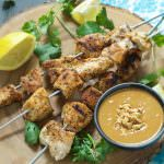 Garlic infused chicken skewers are chargrilled then drizzled with a homemade szechuan peanut sauce that will quickly become a family favorite!