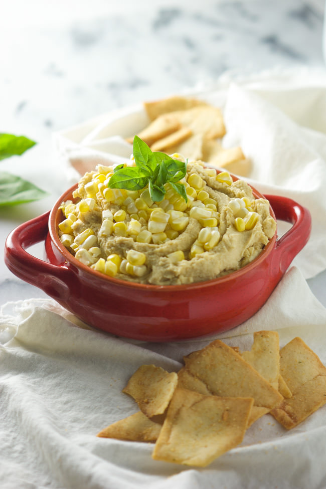 This Sweet Corn & Basil Hummus is filled with summer flavors and only takes 5 minutes to prepare!