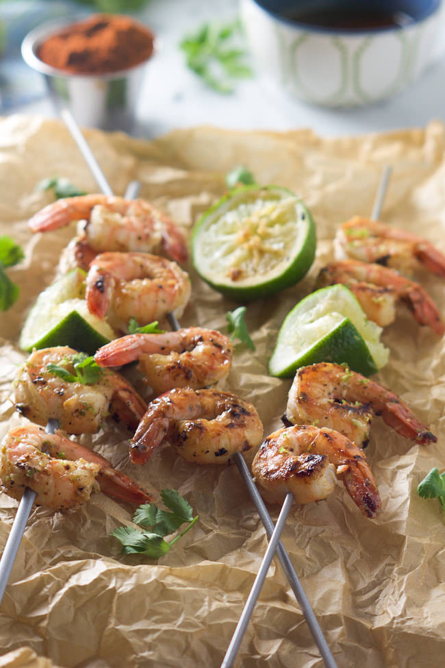 Sweet and saucy spicy cilantro shrimp skewers are ready in 20 minutes and dunked into a honey lime sauce! Healthy and bursting with flavor!