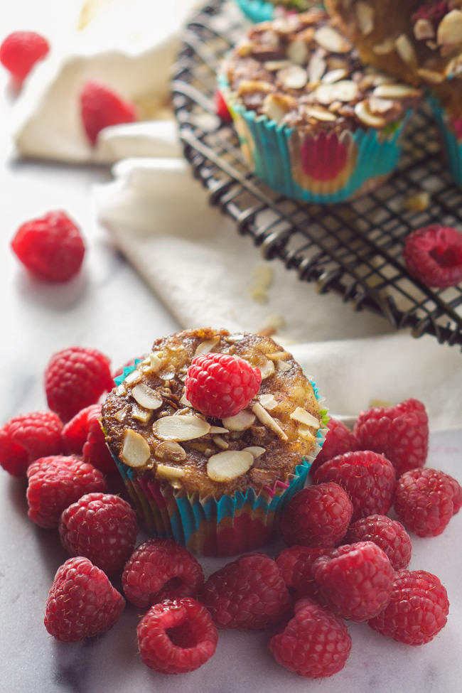 Sweet and tender, these Skinny Raspberry Coffee Cake Muffins with Almond Streusel are secretly healthy and bursting with flavor! Something worth getting up for each morning![