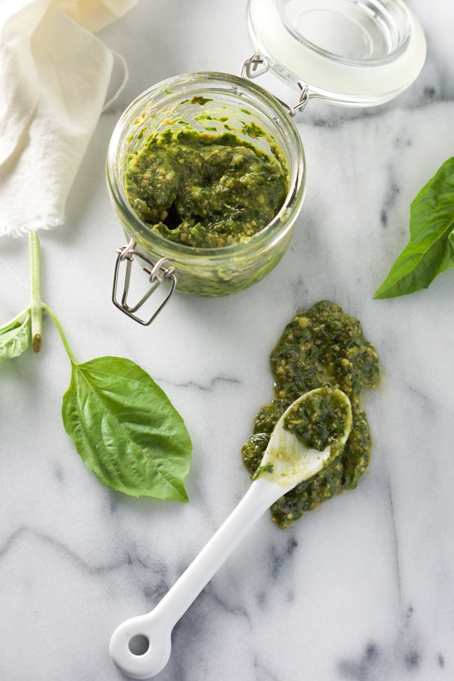 Skinny Sun Dried Tomato Pesto Dip is ultra creamy, filled with pesto and lightened up with light cream cheese and greek yogurt! The perfect party appetizer!