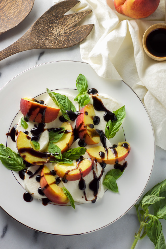 Summer Peach Caprese Salad use tasty summer peaches, creamy mozzarella, fresh basil and finished with a balsamic glaze for a simple no cook dinner!