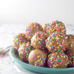 An easy, one bowl birthday cake in the form of donuts! Baked Vanilla Funfetti Donut Holes bake quickly and filled with sprinkles!