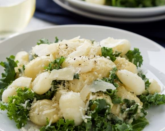 Creamy Garlic Parmesan Gnocchi is a comfort dish that is whipped up in only 15 minutes! Filled with tender gnocchi and kale, then smothered in a light garlic parmesan sauce!