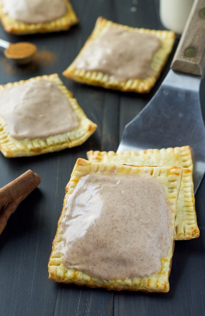 Skip the store-bought and make these simple, fall inspired Pumpkin Brown Sugar Cinnamon Pop Tarts! Using premade pie crusts, they come together quick and are perfect for any morning!