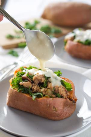 Kale and Sausage Stuffed Sweet Potatoes with White Cheese Sauce-4