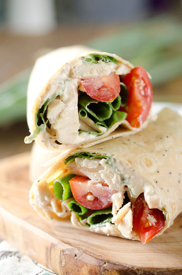 Light Chipotle Ranch Chicken Wrap is an easy wrap with rotisserie chicken, tomatoes, spinach, green onions and a spicy Chipotle Greek yogurt sauce for a healthy lunch!