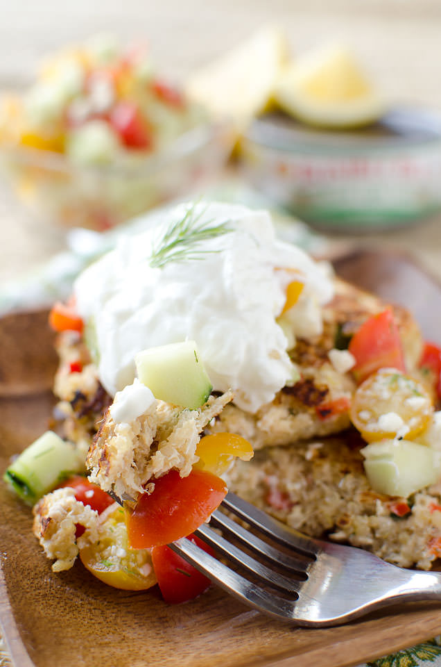 Mediterranean Tuna & Quinoa Cakes are a quick and easy dinner recipe that is not only healthy, but satisfying and delicious! Made with super foods like tuna and quinoa and piled high with Greek yogurt, cucumbers and tomatoes, this dish will be leaving you begging for more.