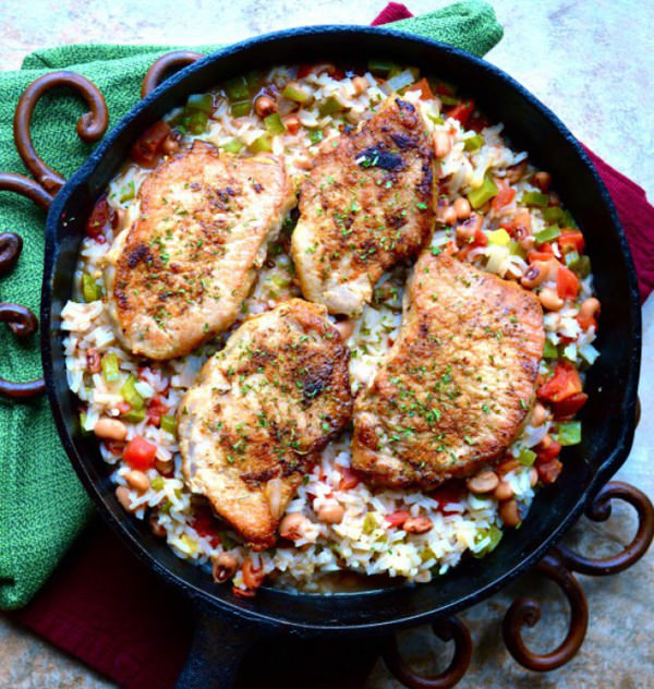 Spicy Pork Chops and Rice is a dish filled with zesty rice, tomatoes, and black beans, simmered to perfection and topped with tender, spicy pork chops! You won't believe how easy this is!