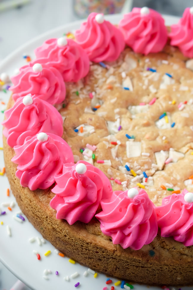 This White Chocolate Funfetti Cookie Cake is a spin on the classic cookie cake - a buttery cookie filled with white chocolate chunks and loads of sprinkles!