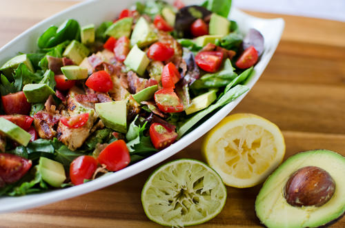 This Chicken BLT Salad is so fresh and filling for a great meal on a summer day with it's flavorful tangy citrus tomatillo dressing!