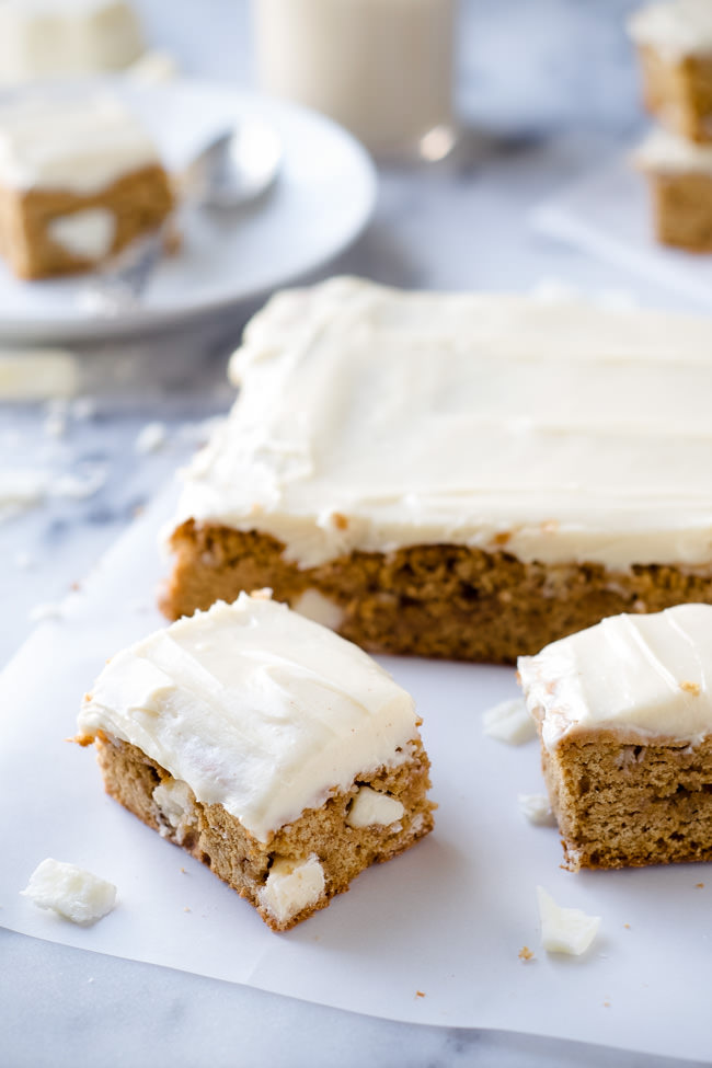 Pumpkin Spice White Chocolate Blondies are super chewy, loaded with white chocolate and topped with an irresistible brown butter maple frosting!