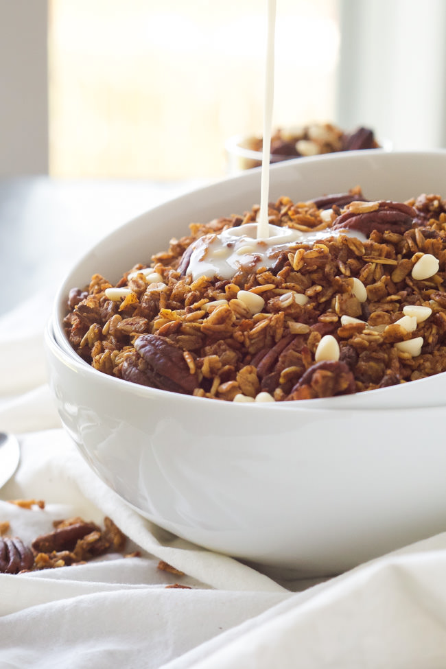 A slow cooker makes this granola so easy to make! Filled with fall flavors, this Slow Cooker Pumpkin Granola has roasted pecans, cranberries and white chocolate!