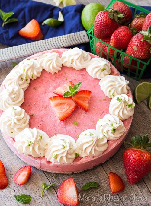 This Skinny Strawberry Daiquiri Pie is the perfect frozen treat. Loaded with sweet strawberries, fresh lime juice and a lightened up pretzel crust, you'll be feeling like your sipping on your favorite cocktail.