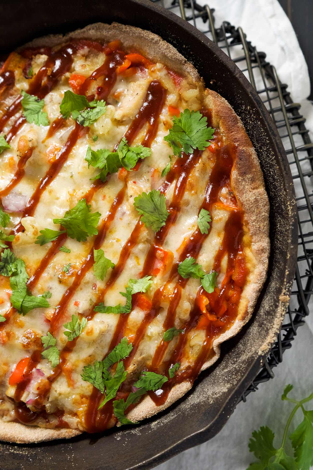 This pizza has two things going for it: sweet and spicy pizza done in one pan. Uno pan. And second, it's cooked in a skillet! The result? One speedy dinner that is crazy good. One point for Megan.