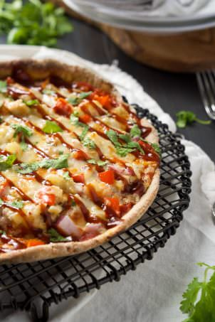 Cast Iron Skillet Chipotle BBQ Chicken Pizza is our new favorite way to make pizza! Sweet and spicy BBQ Chicken pizza has a crispy crust thanks to the cast iron skillet!