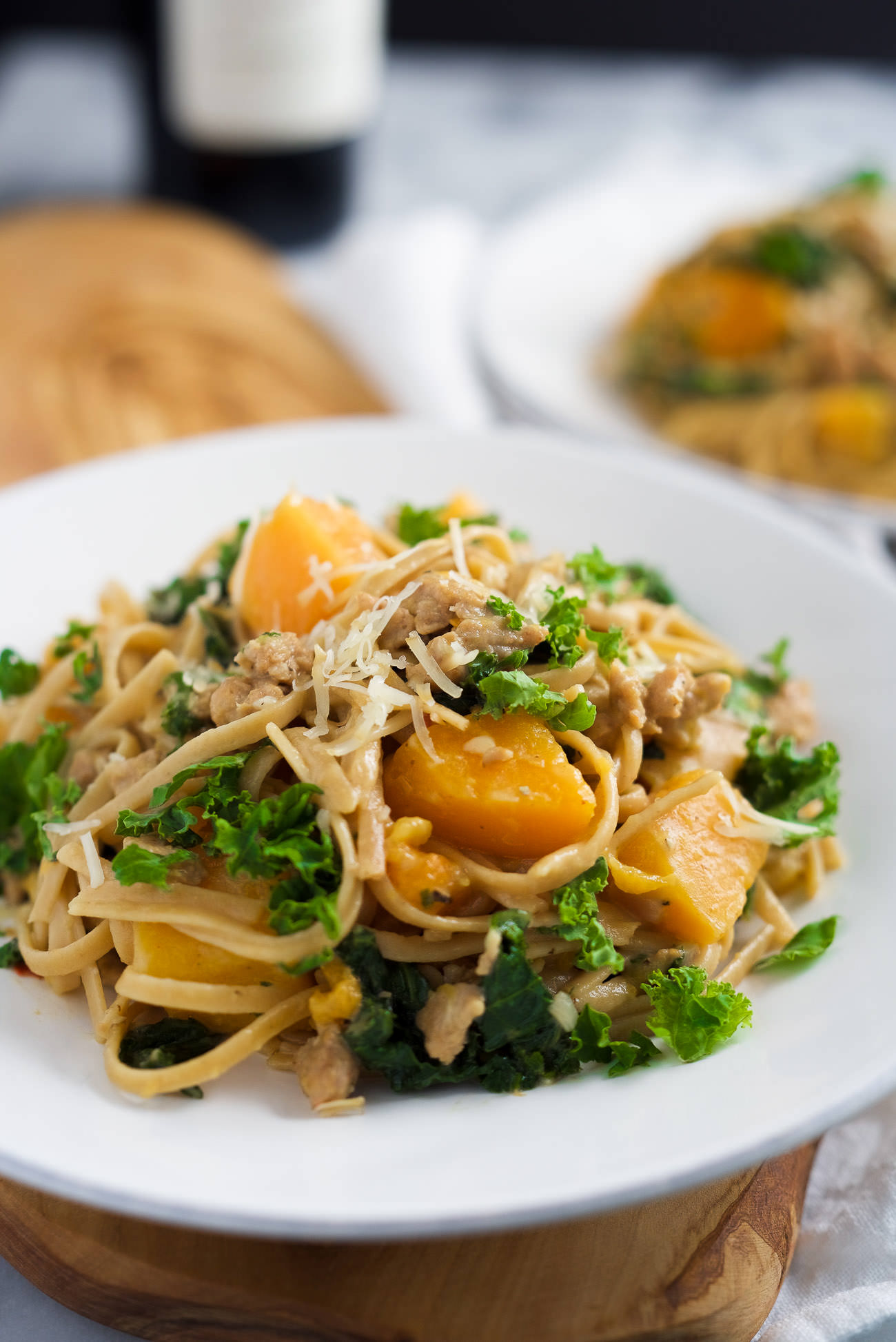 Butternut Squash Linguine Pasta is filled with whole wheat pasta, sweet Italian turkey sausage, kale, butternut squash and brought together with creamy gruyere cheese! A perfect fall dinner.