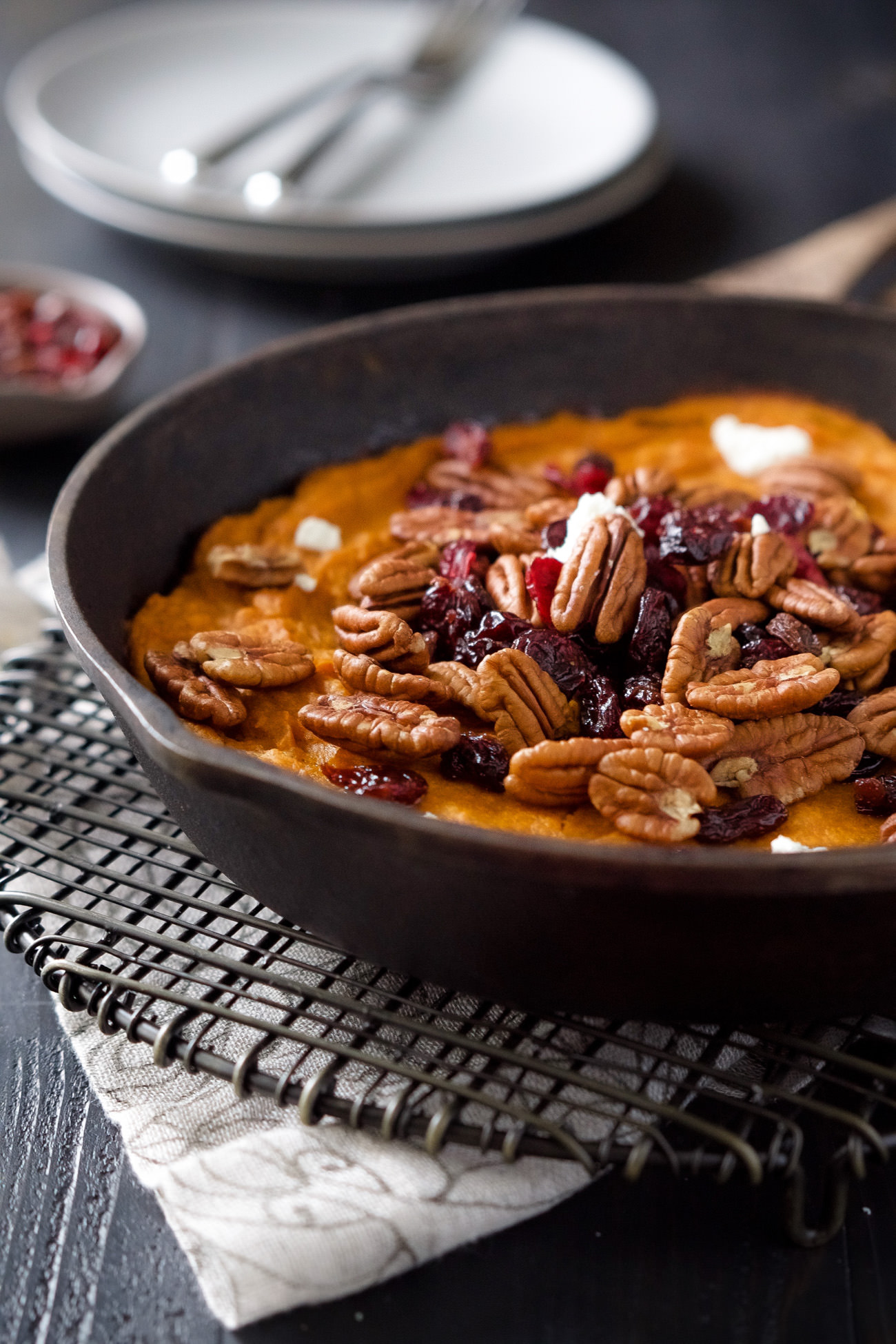 A super easy Vanilla Pecan Sweet Potato Casserole that is filled with whipped sweet potatoes until they're velvety and topped with cranberries and goat cheese!