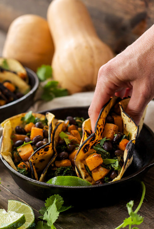Butternut squash, Black Beans, and Kale Tacos seasoned with warm Southwest spices are the perfect pairing in these vegetarian and gluten-free tacos!