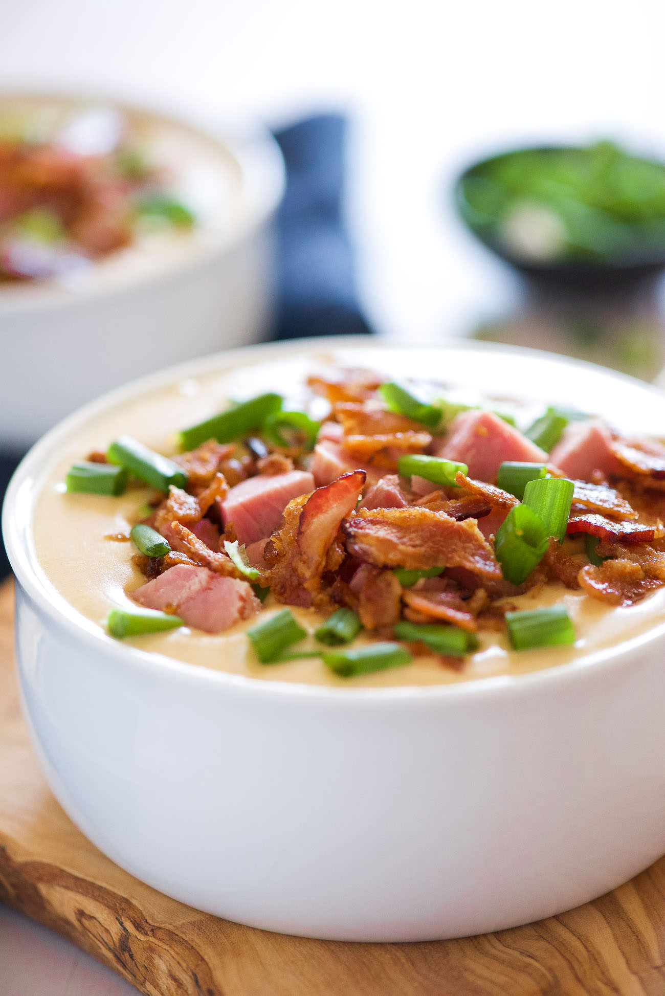 For those cheese and beer lovers - this Ham and White Cheddar Beer Cheese Soup is delicious creamy and full of flavor thanks to two types of cheese, beer, ham and bacon!