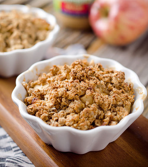 Healthy Peanut Butter Apples Crisp for Two is the perfect dessert recipe for two with tart apples, creamy peanut butter and crunchy granola crumble. If you are looking for a light and easy dessert, this apple crisp is just the thing!