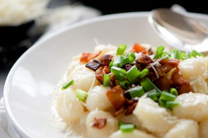 Loaded Baked Potato Gnocchi is a creamy one pot meal with a luscious parmesan sauce, crisp bacon and topped with green onions. A healthier and new take on a loaded baked potato!