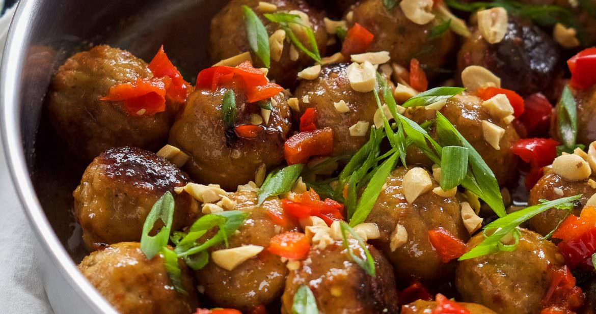 Sweet Chili Glazed Meatballs are juicy meatballs drenched in a homemade sweet chili sauce that is sweet and spicy! A crowd pleasing 30 minute appetizer or an easy dinner served with rice!