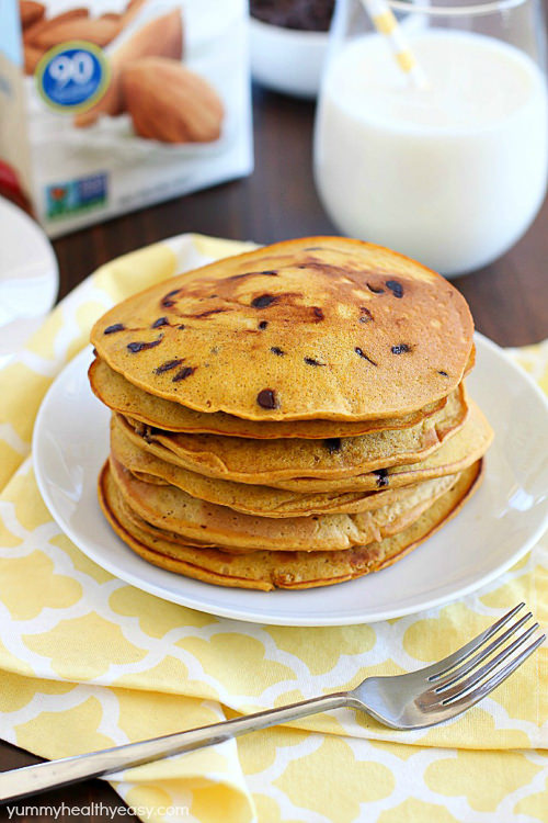 Flavorful Dairy-Free Whole Wheat Chocolate Chip Pumpkin Pancakes are full of awesome fall flavors and how can ayone turn down chocolate for breakfast?!