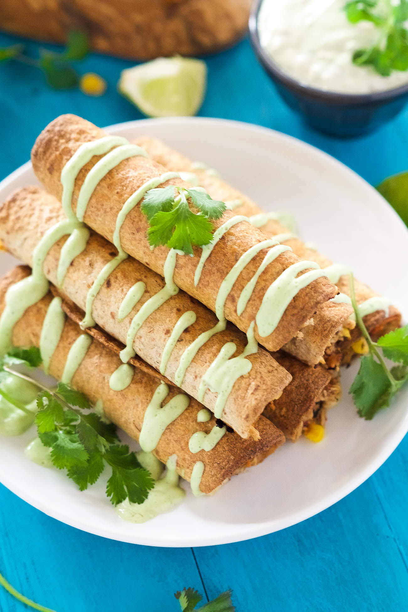 Cheesy Firecracker Baked Chicken Taquitos are a healthier alternative to their store bought sidekicks! Filled with gooey, spicy cheese, corn, chicken and peppers, they are super crispy thanks to a quick bake in the oven!