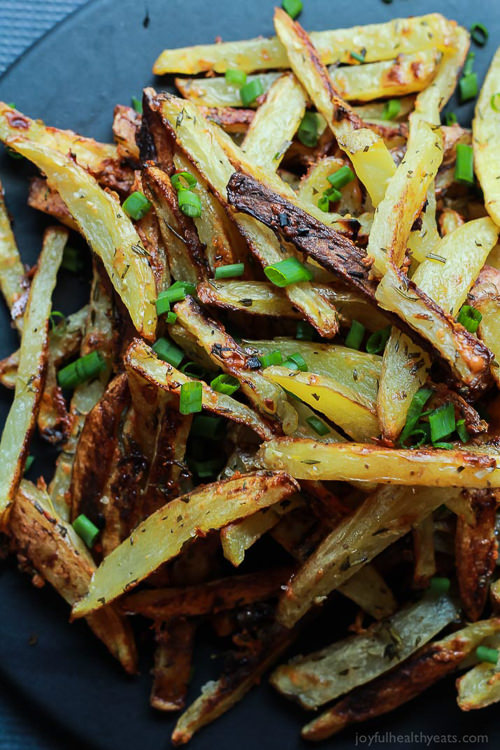 Crispy Baked Garlic Parmesan Fries are crispy on the outside and soft on the inside, the easiest Baked Fries you will ever make! Only 6 ingredients but pack a phenomenal fresh herb taste!