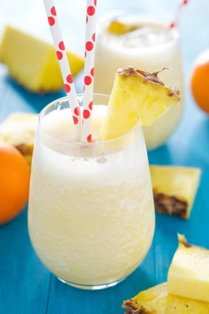This creamy, 5 ingredient smoothie tastes like a tropical cocktail and an orange julius! A protein and vitamin C packed treat to start your day or get you through a long afternoon!