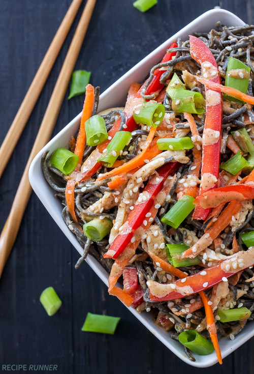 Shredded sesame chicken, red bell peppers, carrots and black bean noodles tossed in a delicious almond butter based Asian sauce are the perfect blend of flavors in these healthy sesame chicken noodle bowls!