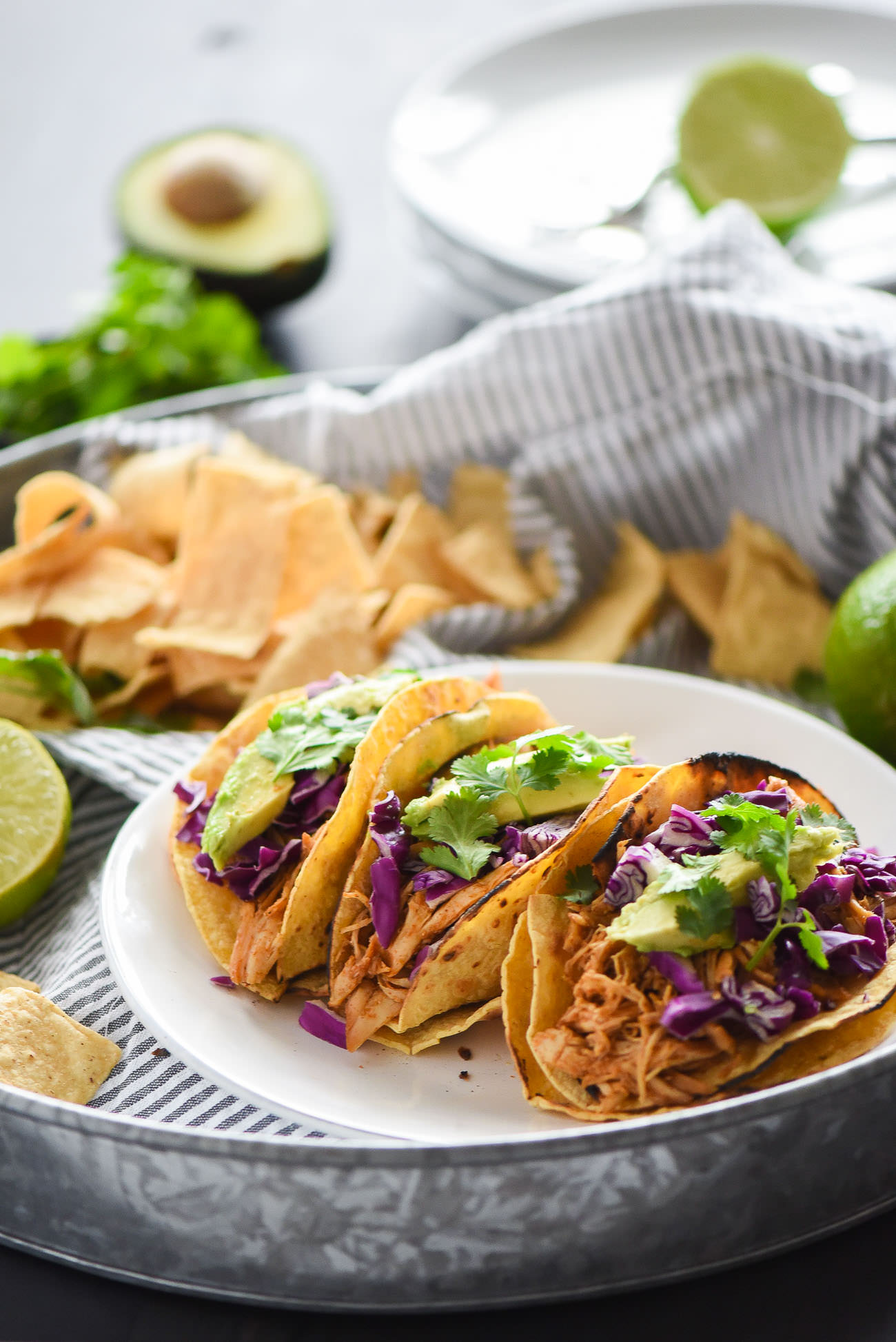 Slow Cooker Honey Chipotle Chicken Tacos are slightly sweet and slightly spicy! The slow cooked chicken is fall apart tender, juicy and full of chipotle and honey! Delicious in tacos or over lettuce for a lighter option!