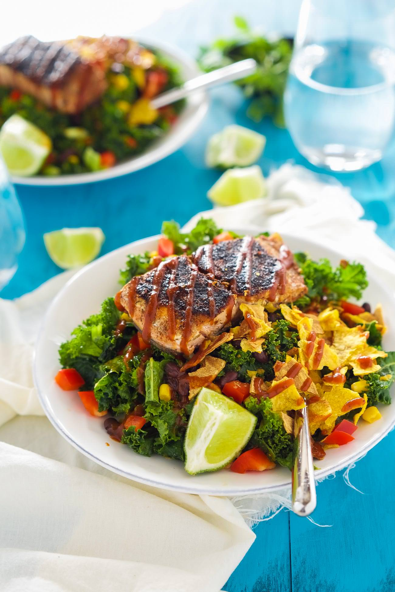 BBQ Salmon Kale Salad is a healthy and updated version of the classic BBQ salad! Filled with bold flavors, crunchy kale, crispy vegetables and all toss in a Honey Chipotle Vinaigrette! One easy to prepare salad you will fall in love with!