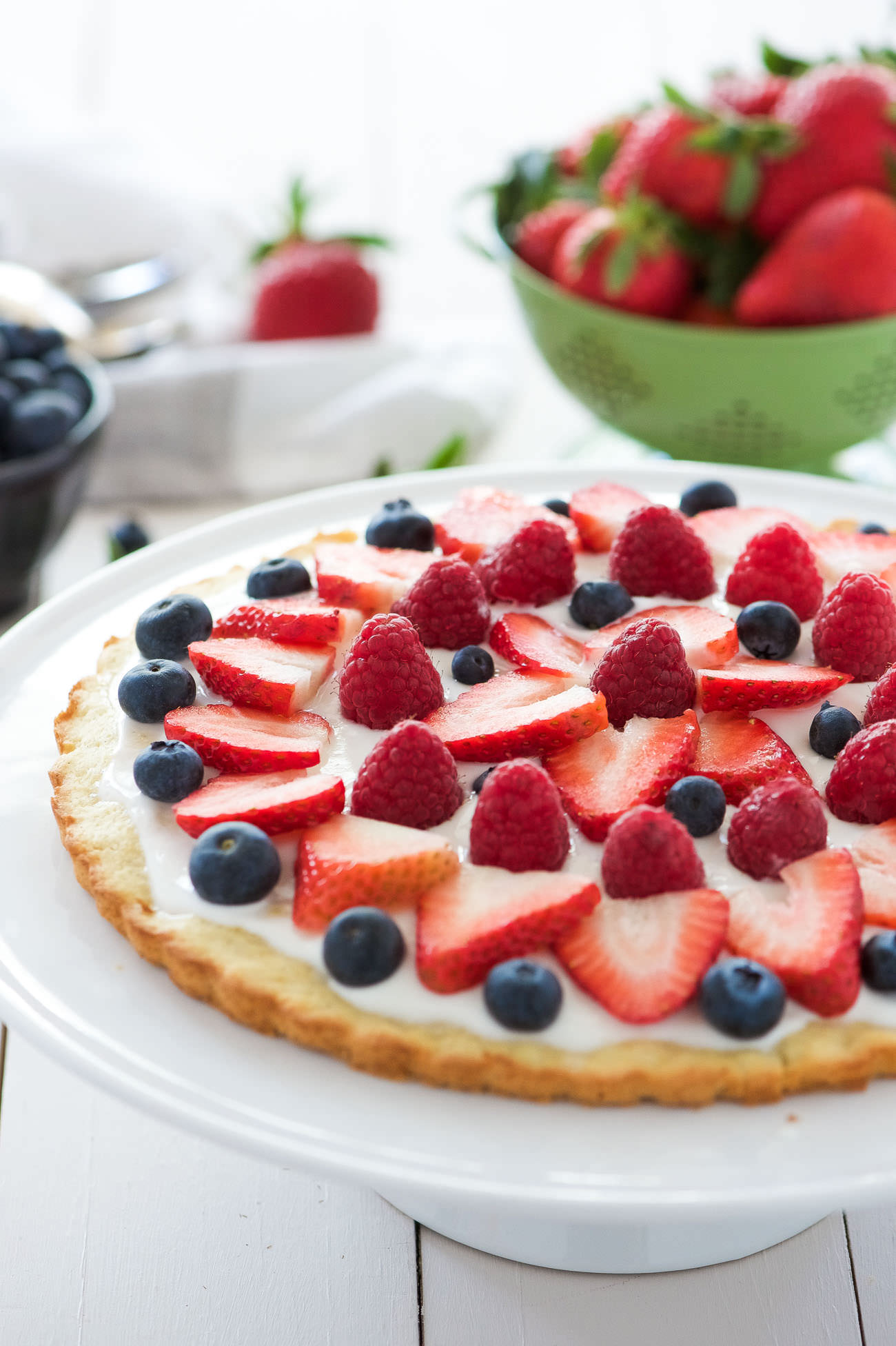 This Berry Tart with Lemon Cookie Crust has made all my spring dessert dreams come true! A citrus cookie crust topped with vanilla greek yogurt and fresh berries! The ideal and simple dessert to impress any guest!