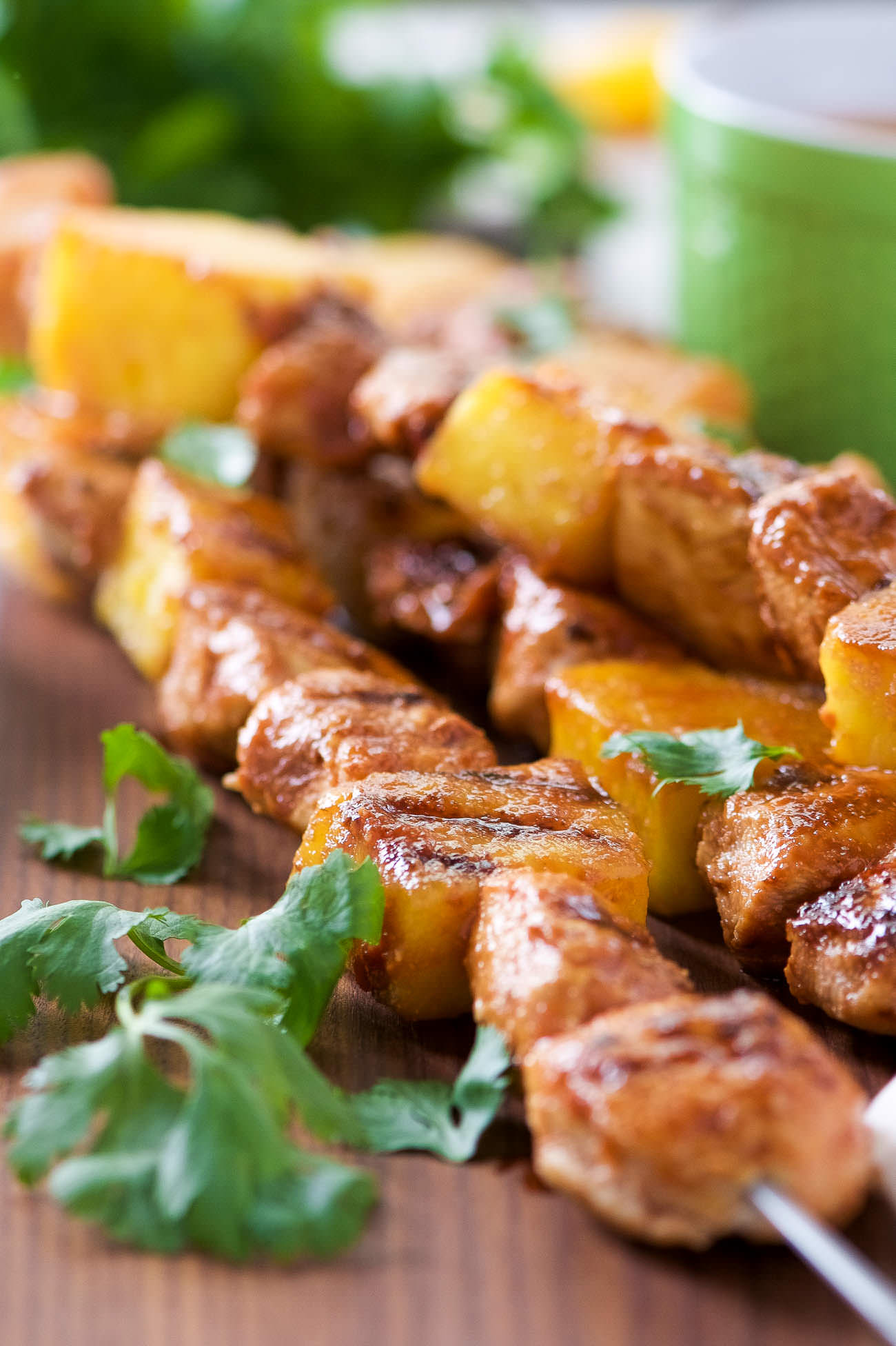 Grilled Huli Huli Chicken Kabobs - Juicy pineapple and tender chicken coated in a sweet and savory glaze then grilled to perfection! The perfect summertime, quick dinner!