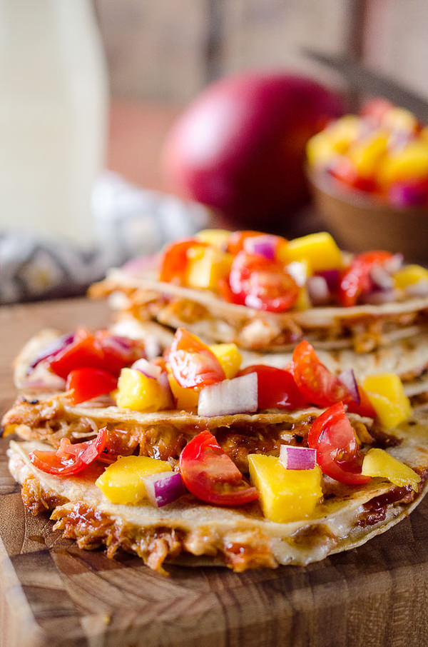 Mango BBQ Chicken Quesadillas are a light and easy dinner idea bursting with bold flavors from homemade Mango BBQ Sauce and topped with fresh Mango Salsa.