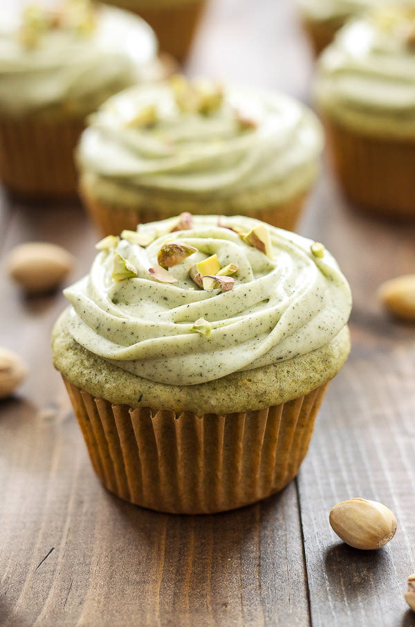 These naturally green cupcakes are infused with green tea powder and full of chopped pistachios. Top them with a delicious matcha cream cheese frosting for an impressive and tasty dessert!