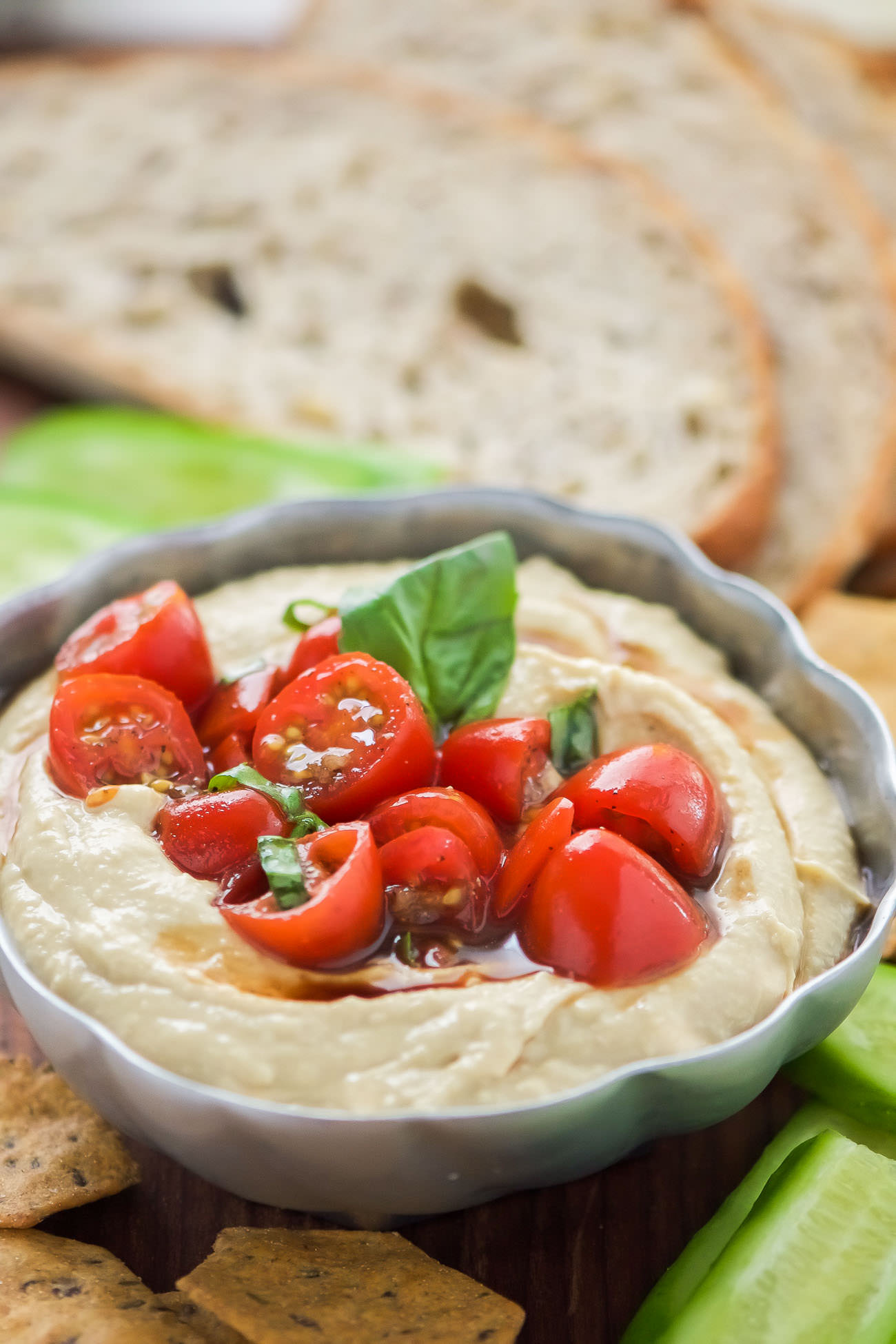 This 5 Minute Bruschetta Hummus is the ideal summer appetizer! The classic Italian flavors shine through with the homemade cherry tomato and garlic bruschetta that pairs perfectly with creamy hummus!