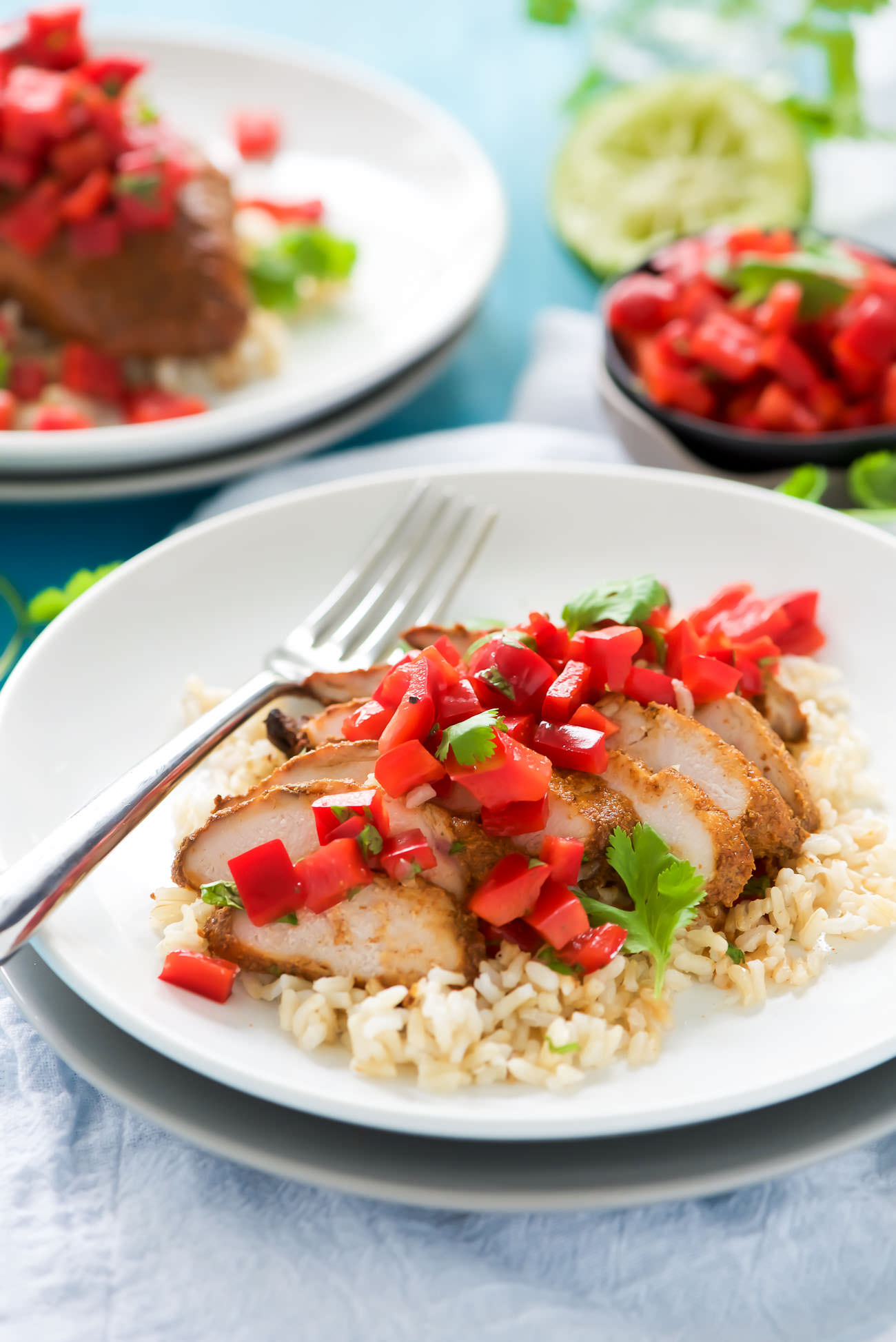Tequila Honey Lime Chicken - juicy chicken marinated in a smoky chipotle, a touch of honey and chili powder then finished with a super quick and fresh red pepper salsa!