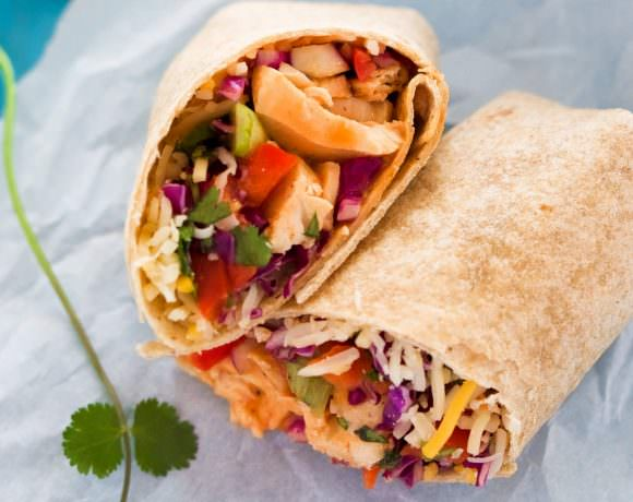 These Hot & Spicy Thai Chicken Wraps is the perfect quick dinner or lunch! Filled with a spicy thai slaw, grilled chicken, pepper jack cheese and drizzled with an addicting Sriracha honey aioli!