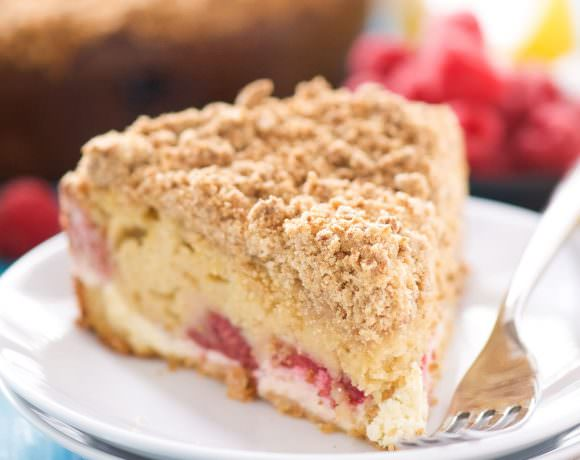 This Lemon Berry Cream Cheese Coffee Cake is the answer to your brunch prayers! A lightened up coffee cake that is bursting with spring flavors, filled with a creamy cream cheese swirl and a thick crumb layer!
