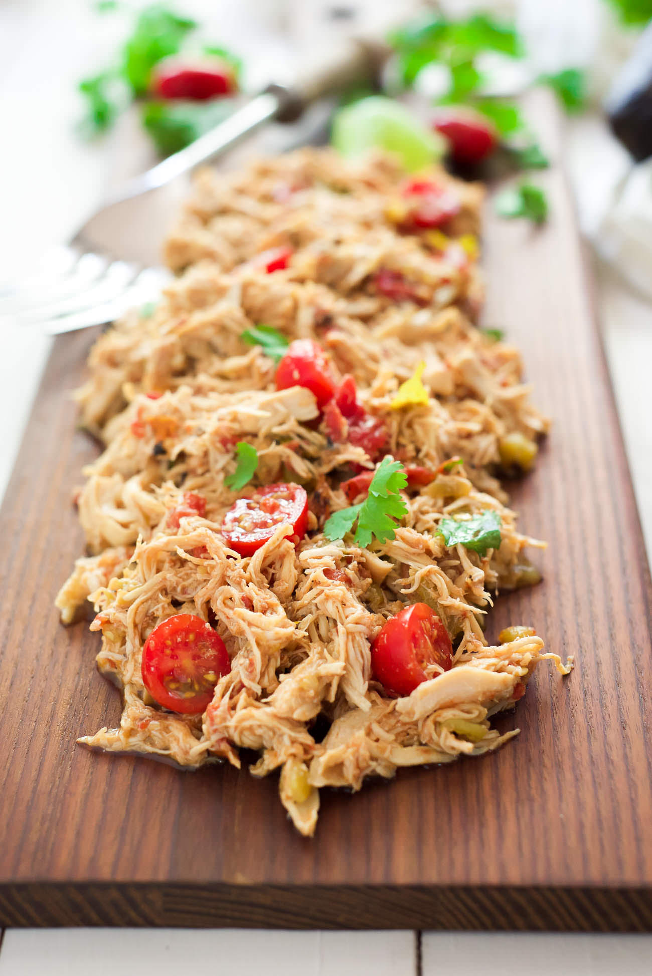 My Favorite Slow Cooker Shredded Mexican Chicken is a time saver and household top pick! Simply throw the chicken in with seasonings and come home to perfectly juicy, shredded chicken! Add to enchiladas, tacos or top salads!
