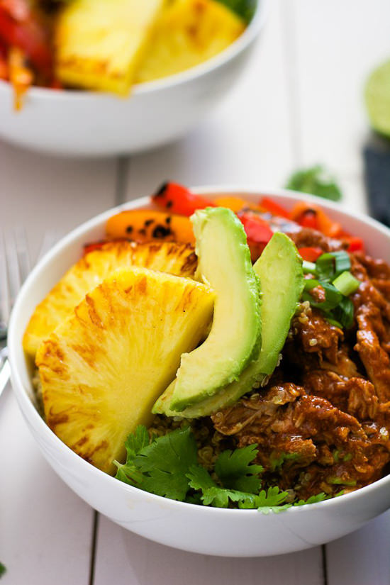 Change up Taco Tuesday with these Slow Cooker Hawaiian Pork Burrito Bowls! They cook all day in a homemade enchilada sauce then topped with sautéed peppers and juicy, seared pineapple!